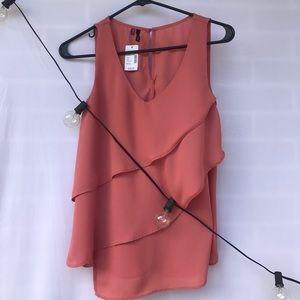 A pink tank top shirt